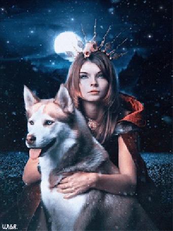 Анимация На фоне луны и звездного неба, где-то в горной местности, под небольшим снегопадом, девушка со странной короной на голове, одетая в теплую красную накидку, сидит в обнимку с собакой породы сибирский хаски, оригинал фотохудожницы Стефани Питино / Stephanie Pitino