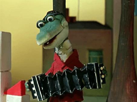 Анимация Крокодил Гена играет на гармошке, мультфильм Чебурашка