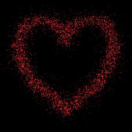 Анимация Красное блестящее сердце на черном фоне