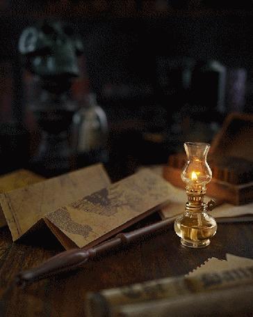 Анимация Горящая свеча на столе, by daria khoroshavina